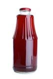 Suco da romã no frasco de vidro Imagem de Stock
