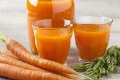 Suco de cenoura fresco Fotografia de Stock