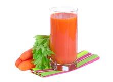 Suco de cenoura fresco com folhas do aipo Imagem de Stock Royalty Free