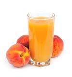 Suco de fruto do pêssego Foto de Stock