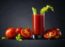 Suco de tomate com tomates e varas de aipo Fotos de Stock