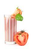 Suco de tomate fresco com folha da manjericão Fotografia de Stock