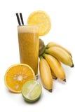 Suco do cal e da banana com laranja Fotografia de Stock Royalty Free