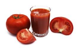 Suco e tomates Fotos de Stock