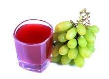 Suco e uvas Imagem de Stock