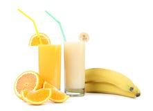 Sucos da laranja e da banana. Frutos. Fotografia de Stock Royalty Free