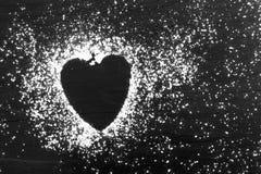 Sucre en poudre en forme de coeur Image libre de droits