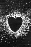 Sucre en poudre en forme de coeur Photos stock
