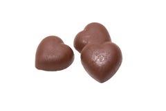 Sucrerie de coeur de trois chocolats sur le fond blanc Photos stock