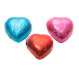 Sucrerie de trois de couleur coeurs de chocolat sur le fond blanc Image libre de droits