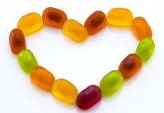 Sucreries colorées de gelée de fruit d'isolement sur le blanc Images stock