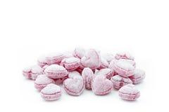 Sucreries en forme de coeur d'isolement sur le blanc Image stock