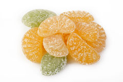 Sucreries oranges de gelée sur le blanc Image libre de droits
