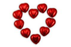 Sucreries rouges de coeurs de chocolat image stock