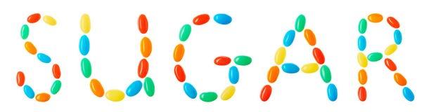 Sucrez le lettrage fait de sucreries multicolores d'isolement sur le blanc Photos stock