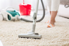 Suction carpet. Suction grey carpet cleaning with vacuum cleaner Stock Photos