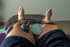 Suction cups applied to a knee in physiotherapy Stock Photo