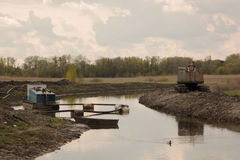 Suction dredge on small river Stock Images