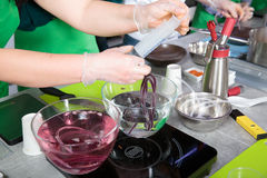 Suction of souce into culinary syringe Stock Image