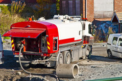 Suction vehicle. Large, powerful suction vehicle and pressure washer car in action at the Tista river in Halden Stock Images