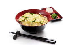 Sudachi Udon. Thick white noodles with sliced Sudachi Royalty Free Stock Photo