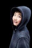 Sudadera con capucha que lleva del muchacho asiático lindo Fotos de archivo