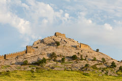 Sudak high mountain part of the fortification of the old fortress against the blue sky background Royalty Free Stock Photo