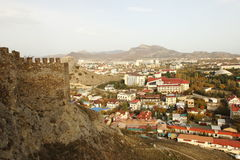 Sudak town and the part of the wall of the fortress in Crimea Stock Image