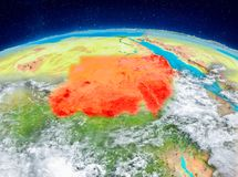 Sudan on Earth. Orbit view of Sudan highlighted in red on planet Earth with highly detailed surface textures. 3D illustration. Elements of this image furnished Royalty Free Stock Photos