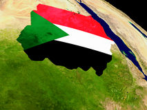 Sudan with flag on Earth Stock Images