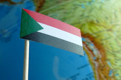 Sudan flag with a globe map as a background Royalty Free Stock Photography