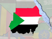 Sudan with flag on globe Royalty Free Stock Photography