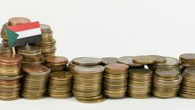 Sudan flag with stack of money coins. Sudan flag waving with stack of money coins stock footage