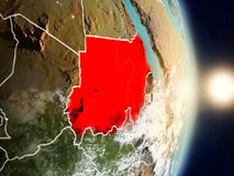 Sudan during sunrise. Highlighted in red on planet Earth with visible country borders. 3D illustration. Elements of this image furnished by NASA Royalty Free Stock Image
