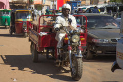 Sudanese man driving his bike. royalty free stock photos