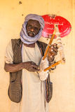 Sudanese man playing a local instrument. Stock Image