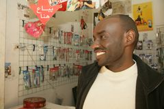 A Sudanese refugee in his mobile phone accessories shop Royalty Free Stock Photo
