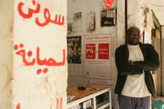 A Sudanese refugee in his mobile phone accessories shop Stock Image