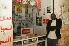 A Sudanese refugee in his mobile phone accessories shop Stock Photos