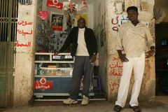 A Sudanese refugee in his mobile phone shop Stock Image