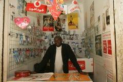 A Sudanese refugee in his mobile phone shop Stock Photos
