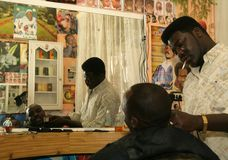 A Sudanese refugee working in a barber shop Stock Photography