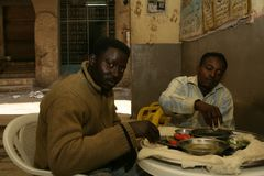 Sudanese refugees having a meal in a restaurant in Cario. Stock Photos