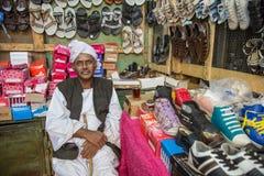 Sudanese shoe salesman Royalty Free Stock Photos