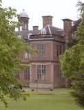 Sudbury Hall (through the trees). View of Sudbury Hall through some trees, Derbyshire, England stock photo