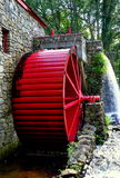 Sudbury, MA: Old Grist Mill Water Wheel. Sudbury, Massachusetts:  The Old Stone Grist Mill with water wheel and cascade still grinds flour for nearby Longfellow' Royalty Free Stock Photos