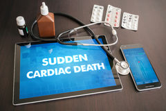 Sudden cardiac death (heart disorder) diagnosis medical concept. On tablet screen with stethoscope royalty free stock photos