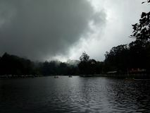 Dark clouds over a lake. Sudden change in weather caused this makeover royalty free stock photography