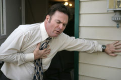 Sudden Chest Pain. A middle aged man experiencing sudden chest pain Stock Images