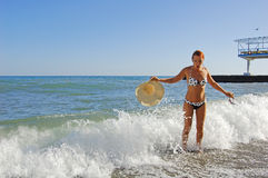 Suddenly sea wave. Girl and suddenly sea wave Royalty Free Stock Photo